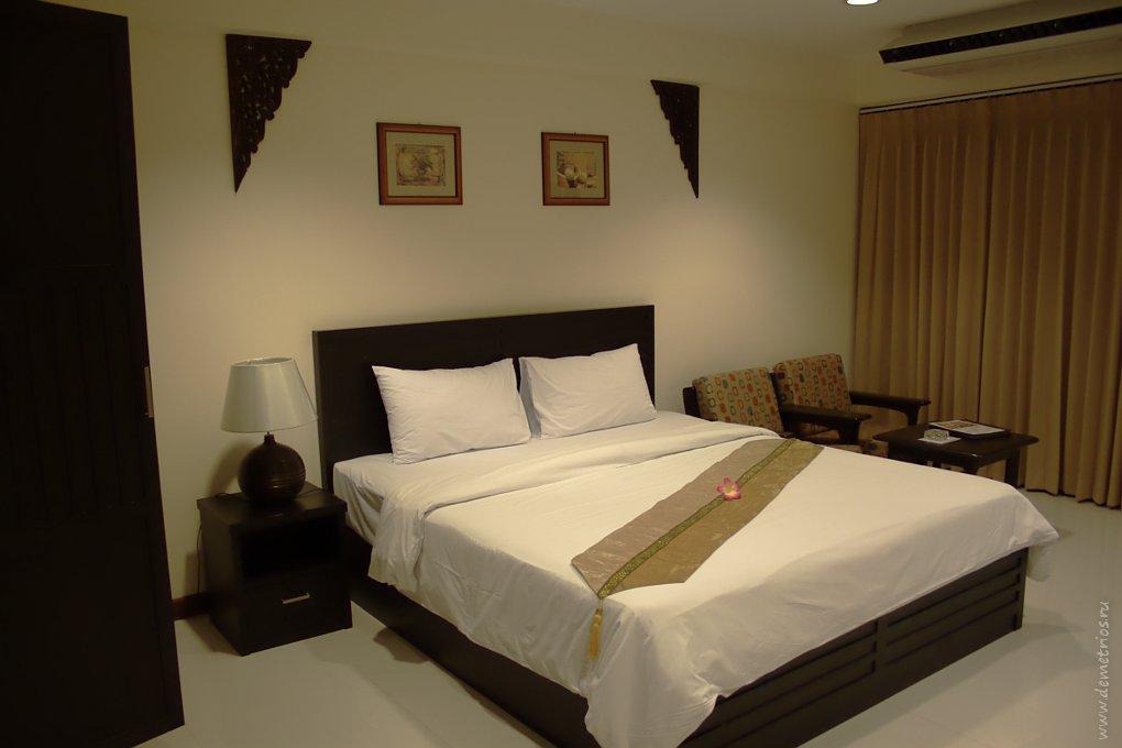 Кровать в True Siam Hotel